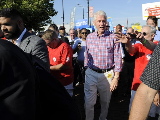 Former President Bill Clinton walks with the crowd during the Labor Day parade.