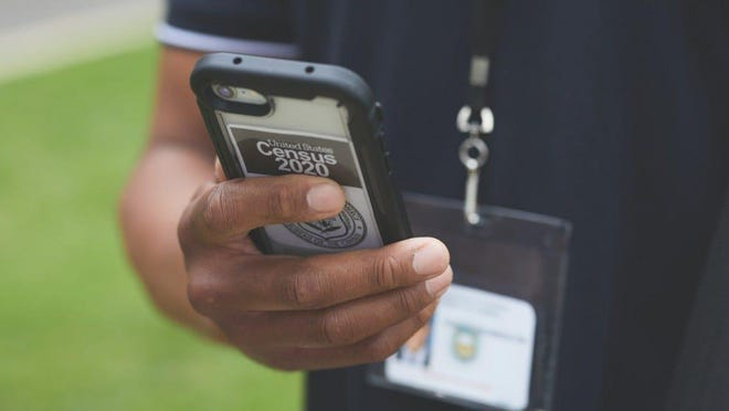 Census takers use devices issued by the Census Bureau to collect census data.
