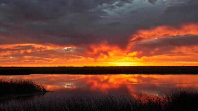 A fiery Kansas sunset at Quivira National Wildlife Refuge.