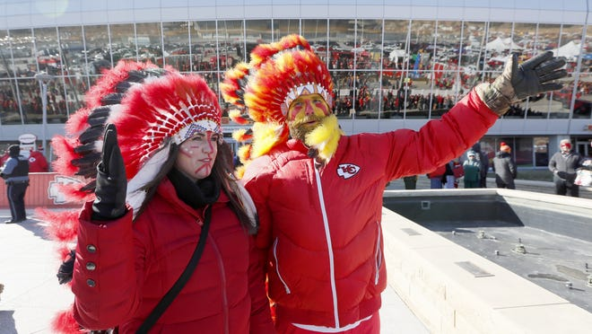 FILE - In this Jan. 19, 2020, file photo, Kansas City Chiefs fans arrive before the NFL AFC Championship football game against the Tennessee Titans Sunday, in Kansas City, Mo. The Chiefs will prohibit the wearing of Native American headdresses, face paint and clothing at Arrowhead Stadium and are discussing the future of the iconic tomahawk chop as they address what many consider racist imagery associated with their franchise.