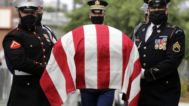 A military honor guard moved the casket of Rep. John Lewis into Ebenezer Baptist Church for his funeral, Thursday, July 30, 2020, in Atlanta. Lewis, who carried the struggle against racial discrimination from Southern battlegrounds of the 1960s to the halls of Congress, died Friday, July 17, 2020.