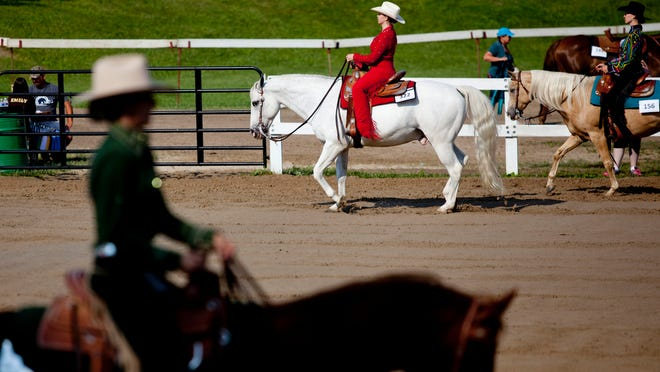 Kelsey Kemp, 19, of Smiths Creek, competes in Western horsemanship on her horse, Edward, during the St. Clair County 4-H and Youth Fair at Goodells County Park.
