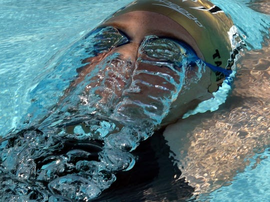 Water runs off the goggles of Becca Rivers, Team COSS-LA,  while swimming the girls 400IM.