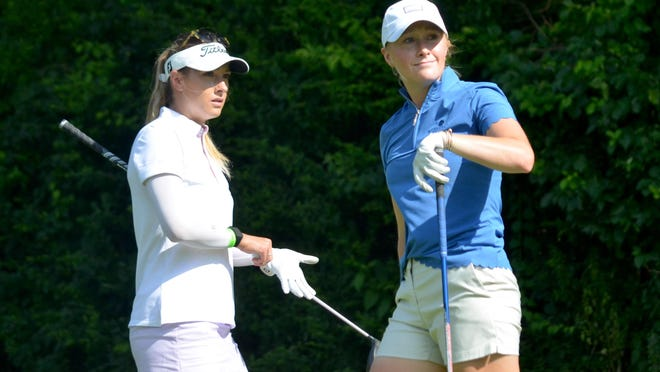 Gabrielle Shipley (left) and sister Sarah Shipley watch Sarah's drive on Friday during the opening round of the Symetra Tour's FireKeepers Casino Hotel Championship at the Battle Creek Country Club.