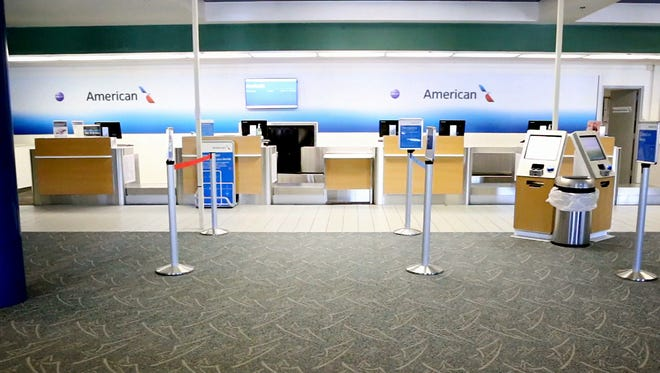 The American Airline check-in counters inside the Elmira Corning Regional Airport sit barren of flyers. The national airline will pull out of the local airport and Greater Binghamton Airport in 2017.