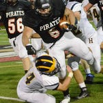 Austin Staebler rushed for 205 yards and three touchdowns, leading the Pirates to a 38-15 upset of Grand Blanc.