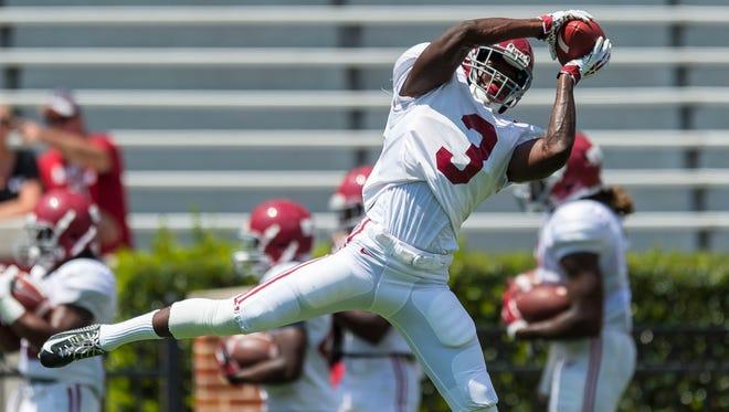 Alabama wide receiver Calvin Ridley works through drills Saturday.