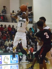 Peabody's Cedric Russell (1, far left) shoots three Saturday night against Tioga.