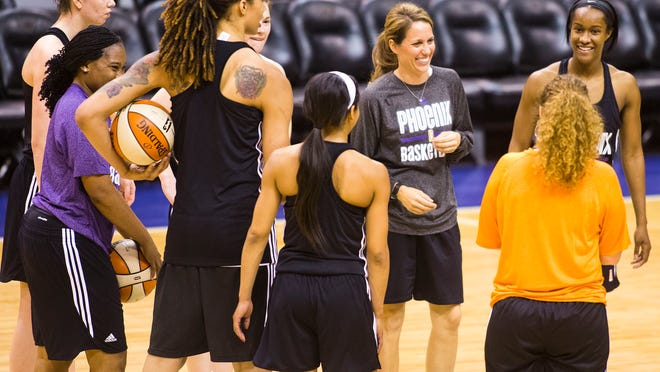 Mercury players gather at US Airways Center on Monday, the first day of practice for the 2014 season.