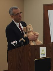 Dr. William Bayer demonstrates how a talking teddy