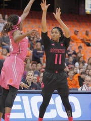 Louisville's Arica Carter, right, shoots over Syracuse's