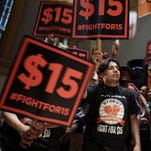 In this June 2015, photo, demonstrators rally for a $15 minimum wage before a meeting of Gov. Andrew Cuomo's wage board in New York.