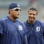 Detroit Tigers designated hitter Victor Martinez, right, stands behind first baseman Miguel Cabrera during batting practice Aug. 26, 2015, in Detroit.