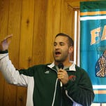 FAMU Strength and Conditioning Coach Parker Brooks thanks the 220 Quarterback Club meeting at the New Times Country Buffet.