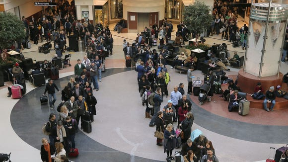 Security lines wrapped through the atrium and around
