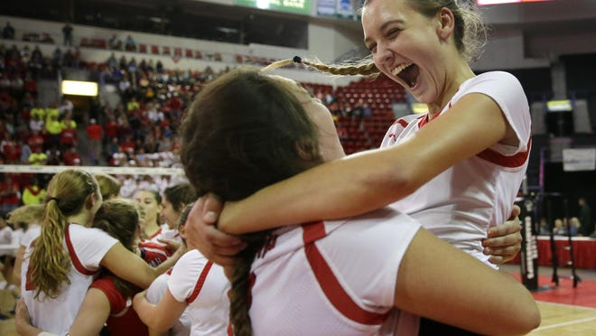 Neenah's Bethany Heinz holds up Addie Barnes after their WIAA Division 1 state semifinal win against Sun Prairie on Friday at the Resch Center in Ashwaubenon.