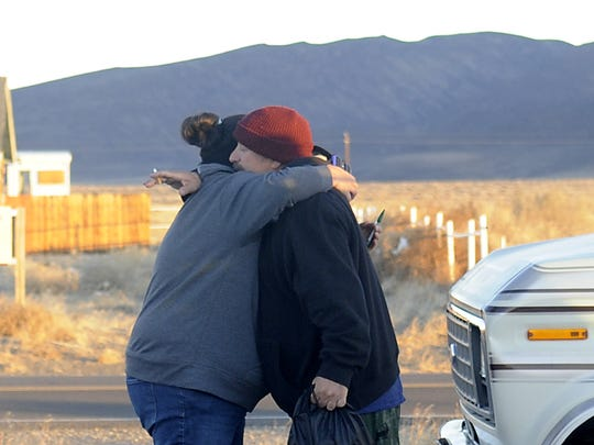 Human Services Case Manager Mikelynn McKinney receives a hug from a man during the homeless count.