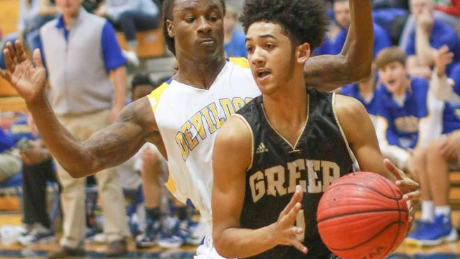 Greer's Cameron Woodruff, right, drives the left baseline as Travelers Rest's Xavier Terry defends during the visiting Yellow Jackets' 79-72 win Tuesday night.