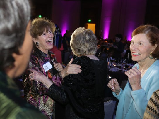 Previous honorees greet each other at the YWCA's Academy