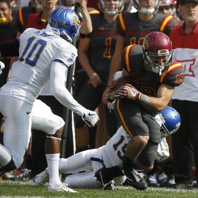 Iowa StateÕs Trever Ryen tries to push past a pair