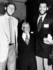 FILE - In this Oct. 20, 1980, file photo, John Wooden, center, former UCLA basketball coach, poses with UCLA alumni and pro basketball stars Bill Walton, left, and Kareem Abdul-Jabbar during a birthday party for Wooden in Los Angeles. Abdul-Jabbar was known as Lew Alcindor when he played for the Bruins in the 1960s. Wooden, college basketball's gentlemanly Wizard of Westwood who built one of the greatest dynasties in all of sports at UCLA and became one of the most revered coaches ever, has died. He was 99. (AP Photo/File)