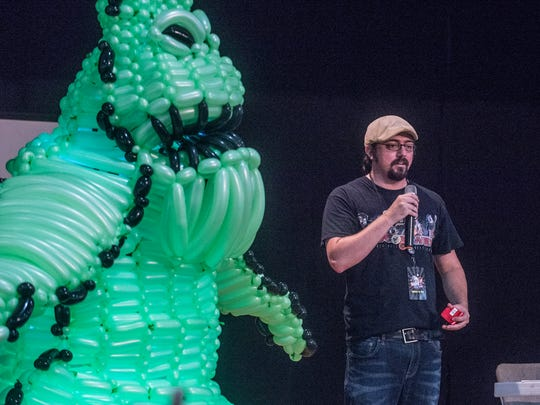 Comic book author and illustrator Brett Brooks speaks to fans, standing next to Bruce Carr's balloon sculpture of Oggie Boogie. The first ever Gump City Con was held Saturday, Aug. 12, at the Alcazar Shrine in Montgomery.