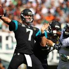 Sep 7, 2014; Philadelphia, PA, USA; Jacksonville Jaguars quarterback Chad Henne (7) throw the ball as Philadelphia Eagles linebacker Brandon Graham (55) tries to defend during the second half at Lincoln Financial Field. Mandatory Credit: Jeffrey G. Pittenger-USA TODAY Sports