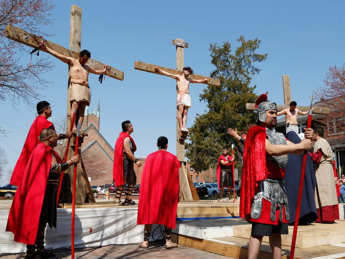 Jesus and two criminals are crucified during the Way of the Cross Friday, April 18, 2014, at St. Boniface Catholic Church. Parishioners of St. Boniface reenact the Way of the Cross, which depicts the final hours in the earthly life of Jesus Christ.