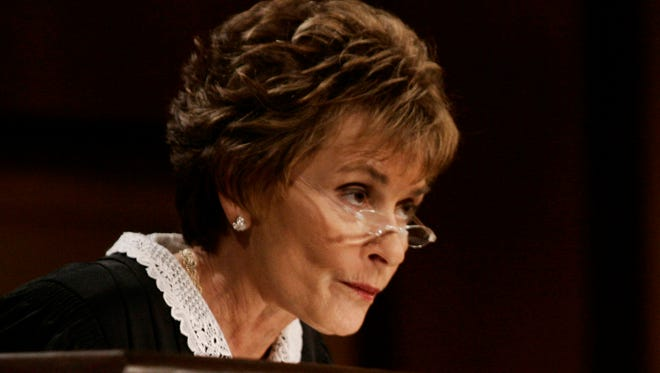 """In this Feb. 2, 2006, file photo, Judge Judy Sheindlin presides over a case on the set of her syndicated show """"Judge Judy."""""""