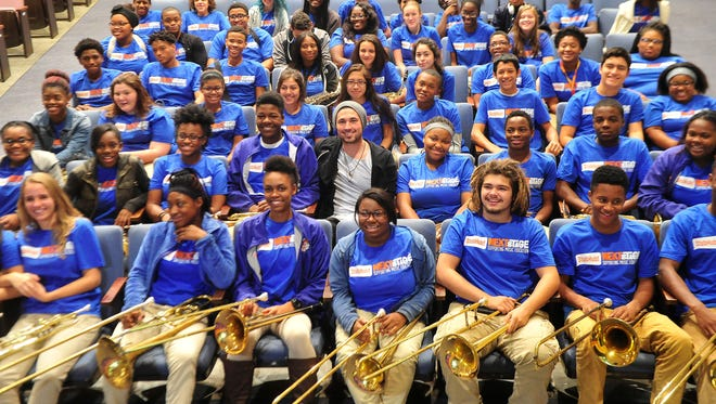 Michael Ray is pictured with the Hunters Lane High School band after The Mr. Holland's Opus Foundation and StubHub made a presentation Monday to donate nearly $39,000 worth of musical instruments at Hunters Lane High School in Nashville.