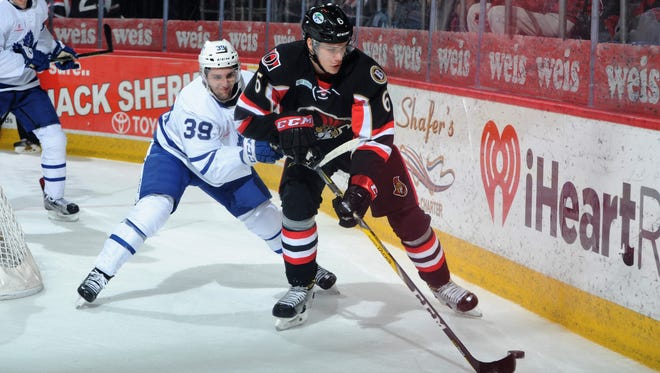 Andreas Englund of the Binghamton Senators beats Toronto's Seth Griffin to the puck during Friday's American League Hockey game at Floyd L. Maines Arena. The B-Sens lost, 6-3.