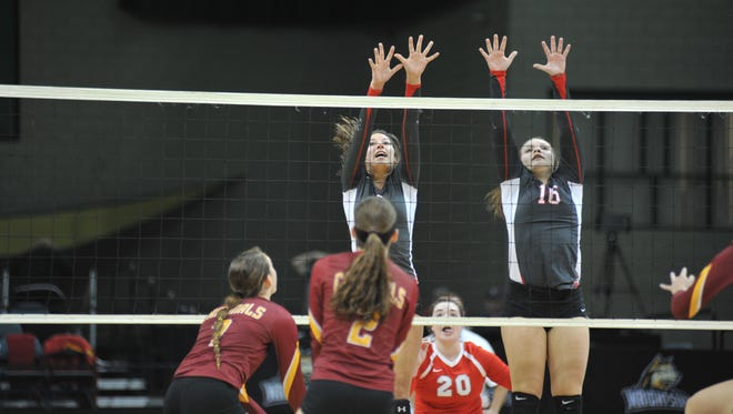 Emily Stump and Ally Sostakowski attempt to block a New Bremen hit in the state semifinal.
