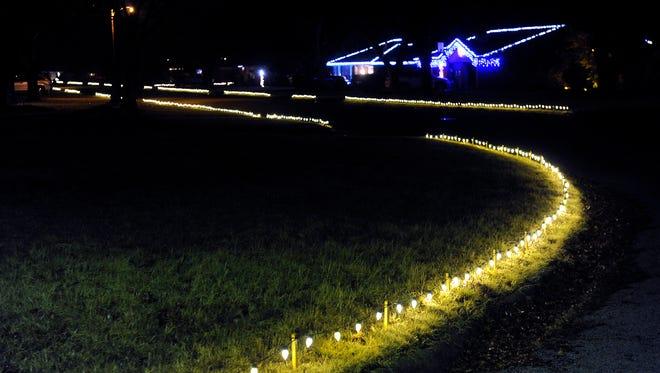 Lights illuminate the curb at River Oaks Circle Tuesday.
