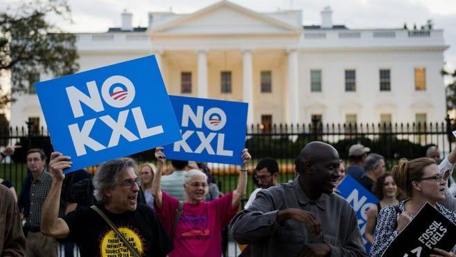 Activists celebrate outside the White House on Nov. 6, 2015.