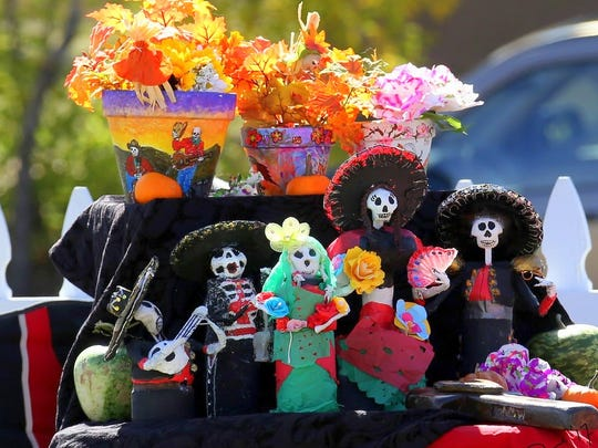 "Decorations featured skeletons performing on musical instruments and enjoying ""life."""