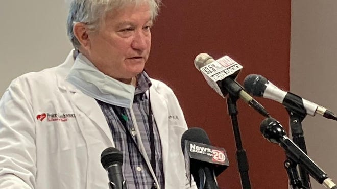 """Dr. Brian Miller, president of the Sangamon County Department of Public Health's board of health, addresses Sunday's news conference. Miller said Sangamon County is """"strikingly close"""" to additional mitigations for bars and restaurants as it combats another wave of COVID-19."""