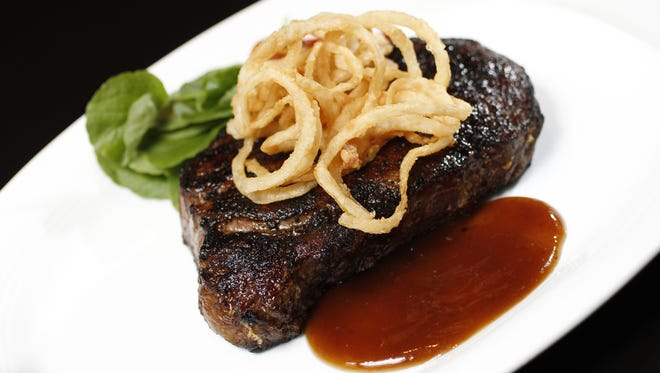 A 14-ounce dry-aged ribeye topped with onion straws from Peterson's in Fishers.