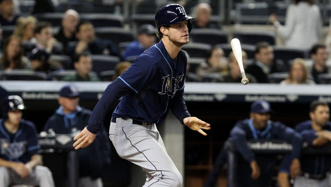 Tampa Bay Rays right fielder Wil Myers toss his bat after hitting a single in the sixth inning against the New York Yankees at Yankee Stadium.