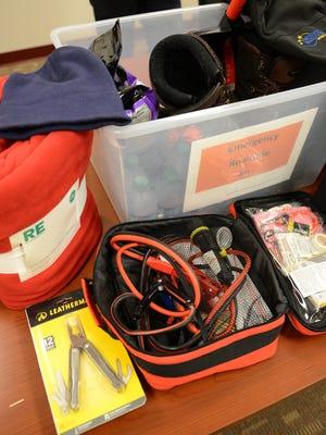 Brown County Emergency Management director Paul Gazdik shows a roadside emergency kit.