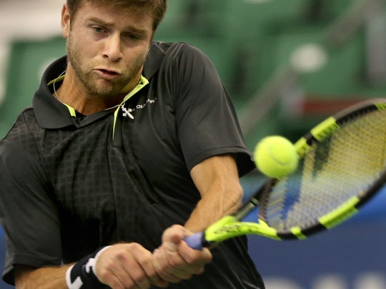 Ryan Harrison (USA) returns a serve against Konstantin Kravchuk (RUS) during their match at the Memphis Open. (Nikki Boertman/The Commercial Appeal)