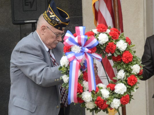 ANI Veterans Memorial Service Harold Teal with American Legion Post 3 presents a wreath during the Veterans memorial Service held Tuesday, Nov. 11, 2014 at Alexandria Veterans Memorial Plaza at Alexandria City Hall. The event was sponsored by the Exchange