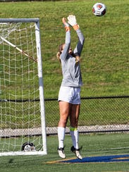 Hartland's Andrea Everett makes one of her 13 saves