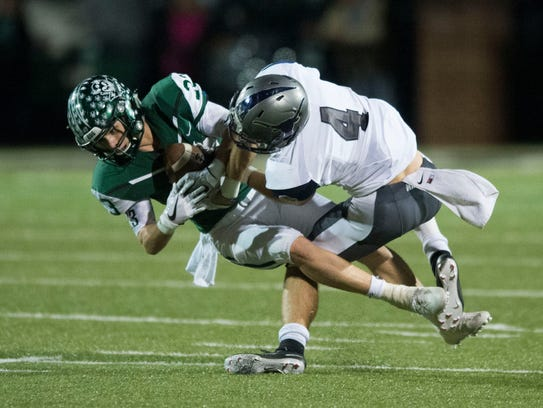 Greeneville's Seth Crawford intercepts a pass intended