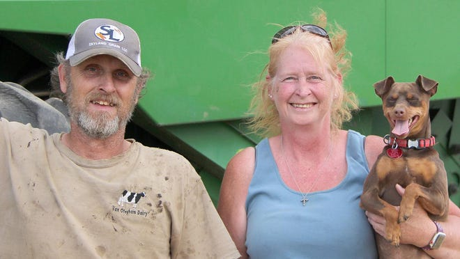 Greg and Sandy Beck of Malcolm, Iowa enjoy their time together as custom wheat cutters. Their harvest run this year started in Pratt and they don't go anywhere without their special dog, Tug.