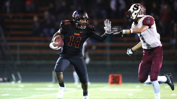 Sprague's Jailen Hammer runs the ball as the Olys take on Sherwood in the second round of the OSAA Class 6A state playoffs on Friday, Nov. 11, 2016, at Sprague High School. Sprague defeated Sherwood 48-47 in overtime.
