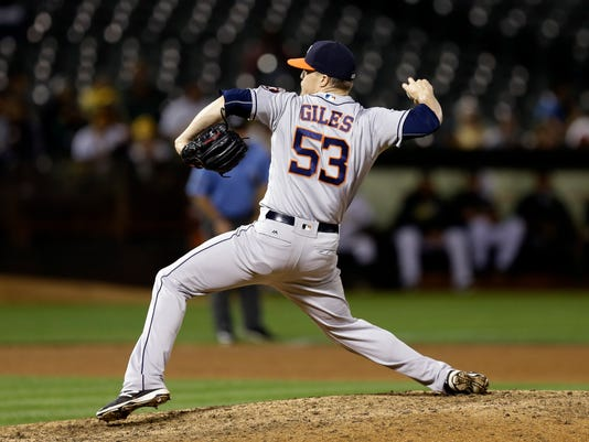 Houston Astros pitcher Ken Giles works against the Oakland Athletics in the ninth inning of a baseball game Monday, Sept. 19, 2016, in Oakland, Calif. (AP Photo/Ben Margot)