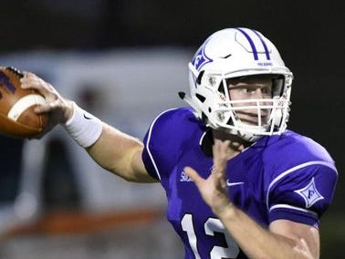 Furman quarterback Reese Hannon (12) will lead the Paladins into Lane Stadium today to face the Virginia Tech Hokies.