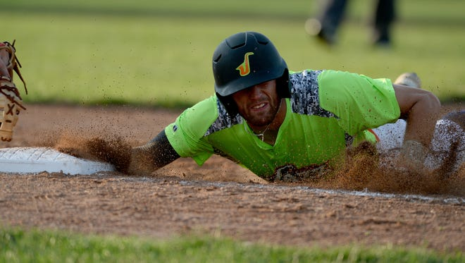 Brennan Laird of the Richmond Jazz dives back to first base against the Southern Ohio Cooperheads during a baseball game on John Cate Field at McBride Stadium Friday, July 8, 2016 in Richmond.