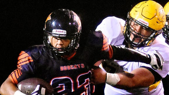 Red Lion's Nick Argento, right, tries to bring down
