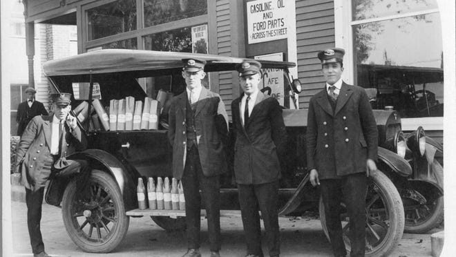 U.S. Customs agents pose with confiscated liquor in Swanton in 1923.